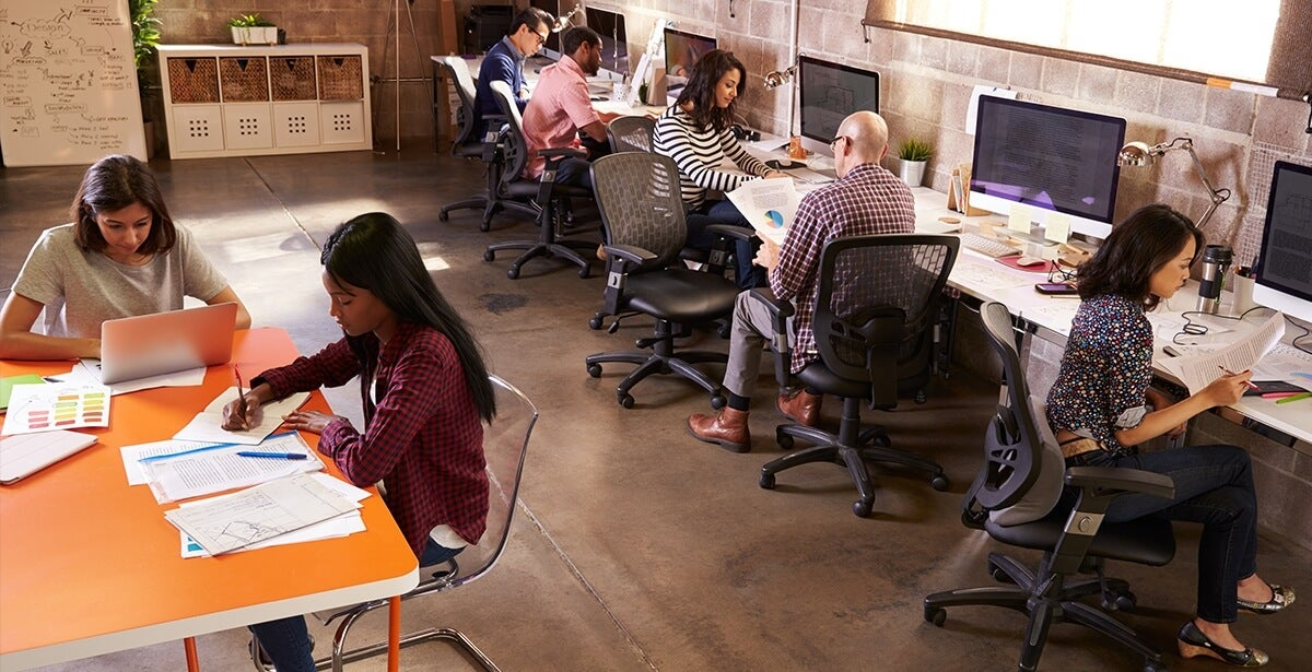 MBA students working in a classroom, laying a foundation for future entrepreneurial success
