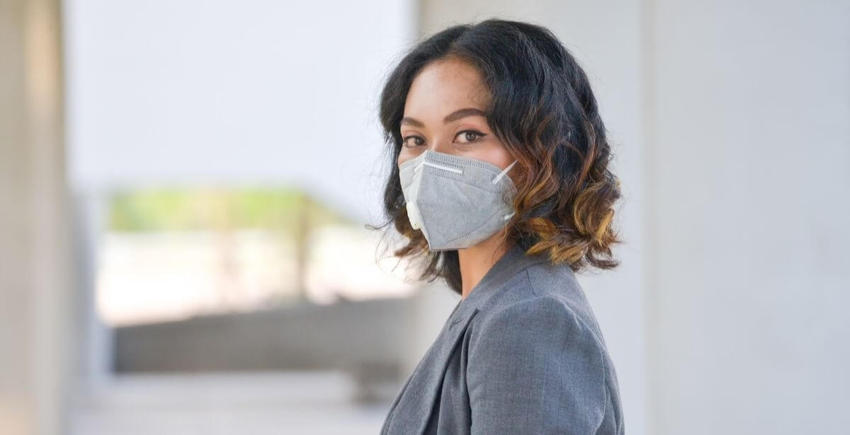 Healthcare administrator wearing a medical mask to protect herself from Coronavirus